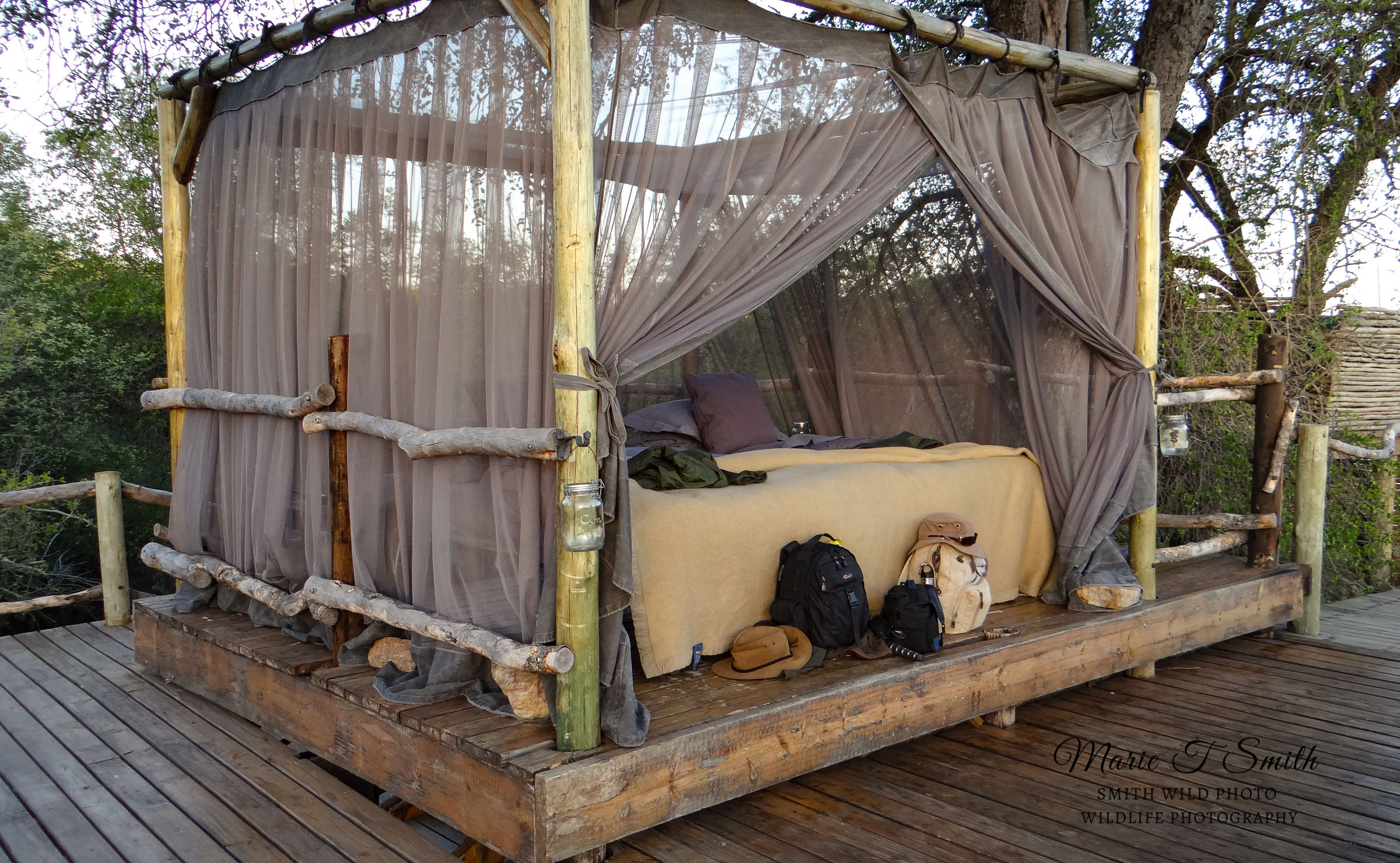 Bed with mosquito net for sleeping under the stars